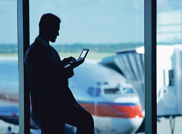 Businessman Using a Palm Pilot